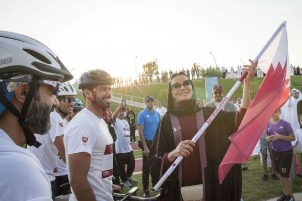 HH Sheikha Moza participates in Al Adaam Flag Relay at Education City